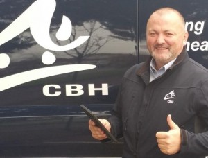 Sean from Cheltenham Borough Homes (CBH) holding a tablet computer